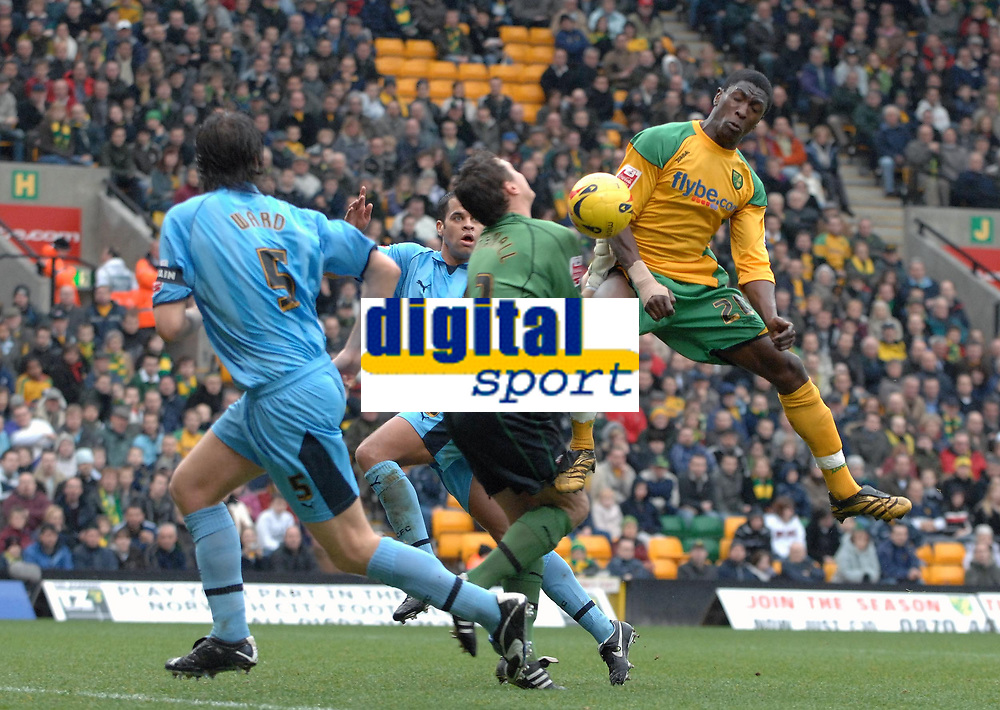 Photo: Ashley Pickering.<br />Norwich City v Coventry City. Coca Cola Championship. 24/02/2007.<br />Dickson Etuhu of Norwich (R) challenges Coventry goalie Andy Marshall