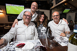 The Italian owners / brothers of Culinarius Italian Restaurant in Cologne visited with us (Ela Dutch of Italy and Dmitry Khitrov of Russia) as we had an incredible meal after a long day at the Intermot Motorcycle Trade Fair. Cologne, Germany. Saturday October 8, 2016. Photography ©2016 Michael Lichter.