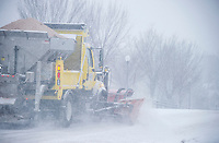 A Laconia Public Works plow drives down Elm Street from Lakeport before mid day Thursday as the storm moved through the region creating slow driving conditions with the intensity of the snowfall.  (Karen Bobotas/for the Laconia Daily Sun)
