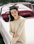 Robin sitting on the back of a vintage 50's car; photographed for Charles Keath.