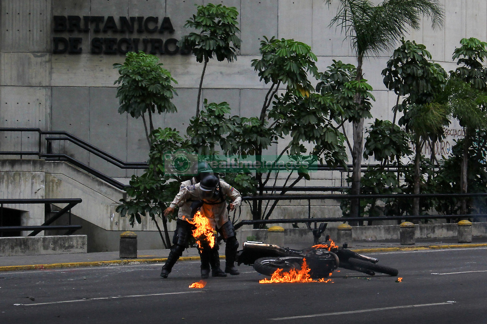 June 5, 2017 - Caracas, Capital District, Venezuela - A group of opposition protesters throw a Molotov bomb at members of the Bolivarian National Police and set it on burning in a demonstration against the government of President Nicolas Maduro this June 5, 2017. (Credit Image: © Adrian Manzol via ZUMA Wire)