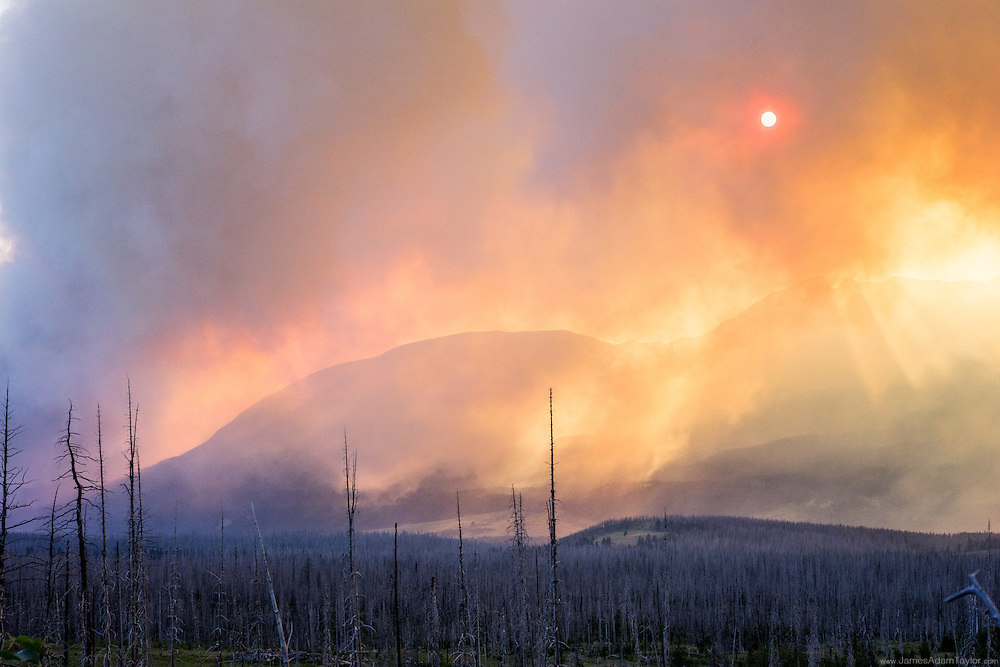 Run light streams through smoke from the Reynolds Creek Fire in Glacier National Park as seen from Highway 89. Tuesday, July 21.