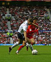Photo: Andrew Unwin.<br />England v Macedonia. UEFA European Championships 2008 Qualifying. 07/10/2006.<br />England's Steven Gerrard (L) competes with Macedonia's Goran Maznov (R).