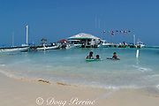 children playing in front of Amigos del Mar dive center<br /> San Pedro, Ambergris Caye, Belize, Central America ( Caribbean Sea )