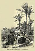 A WELL IN A GARDEN OF HAIFA. Showing a machine, called a sakiyeh, raising water to fill the adjacent tank on the right. Wood engraving of from 'Picturesque Palestine, Sinai and Egypt' by Wilson, Charles William, Sir, 1836-1905; Lane-Poole, Stanley, 1854-1931 Volume 3. Published in by J. S. Virtue and Co 1883