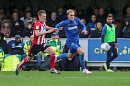 AFC Wimbledon midfielder Mitchell (Mitch) Pinnock (11) chasing through ball during the EFL Sky Bet League 1 match between AFC Wimbledon and Lincoln City at the Cherry Red Records Stadium, Kingston, England on 2 November 2019.