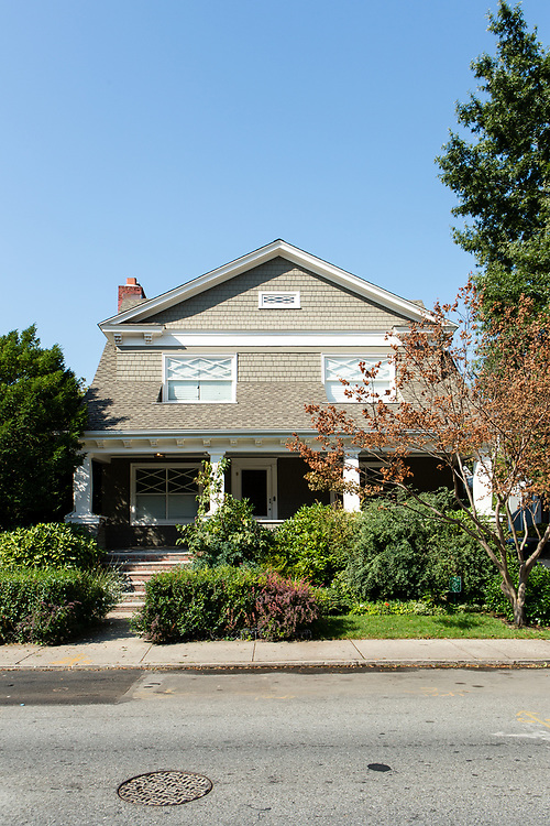 A shingle-style bungalow at 518 E. 16th Street, between Ditmas and Newkirk Avenues.