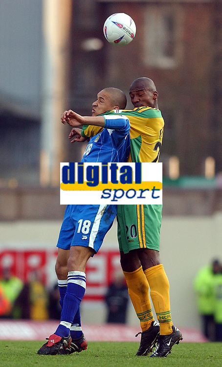 Fotball<br /> Photo: Daniel Hambury, Digitalsport<br /> NORWAY ONLY<br /> Norwich City V Wigan Athletic<br /> Nationwide League  Division One. <br /> 9/04/2004.  <br /> <br /> Norwich City's Damien Francis and Wigan Athletic's Jason Jarrett battle for the ball