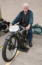 """© Licensed to London News Pictures. 24/05/2015. Warmley, South Gloucestershire UK.  Picture of Henry Body on his Douglas Motorcycles at the annual rally of vintage Douglas Motorcycles at Kingswood Heritage Museum.  Henry Body is 80 years old and his bike is 86 years old.  Henry says he has raced in 276 events and won 271 times. The world famous Douglas bikes were built in Kingswood from 1907 to 1957. Some 25000 were constructed for military use in the First World War. The bikes were regular winners of the Isle of Man TT races. Bill Douglas, great grandson of the founders of the firm, said: """"It is always a stirring sight to see the bikes in action, and we expect a big turnout around the area to watch the cavalcade"""". Photo credit : Simon Chapman/LNP"""