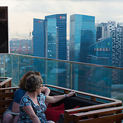 Visitors of Marina Bay Sands Bar enjoying the stunning panorama of Singapore