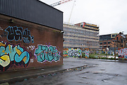 Demolished lot in what was once factories in the industrial area of Digbeth in Birmingham city centre, which is virtually deserted under Coronavirus lockdown on a wet rainy afternoon on 28th April 2020 in Birmingham, England, United Kingdom. Britains second city has been in a state of redevelopment for some years now, but with many outdated architectural remnants still remaining, on a grey day, the urban landscape appears as if frozen in time. Coronavirus or Covid-19 is a new respiratory illness that has not previously been seen in humans. While much or Europe has been placed into lockdown, the UK government has put in place more stringent rules as part of their long term strategy, and in particular social distancing.