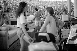 Candace in conversation in the lights booth. The Grateful Dead at Pine Knob Music Theatre, Clarkston, MI on 20 June 1991