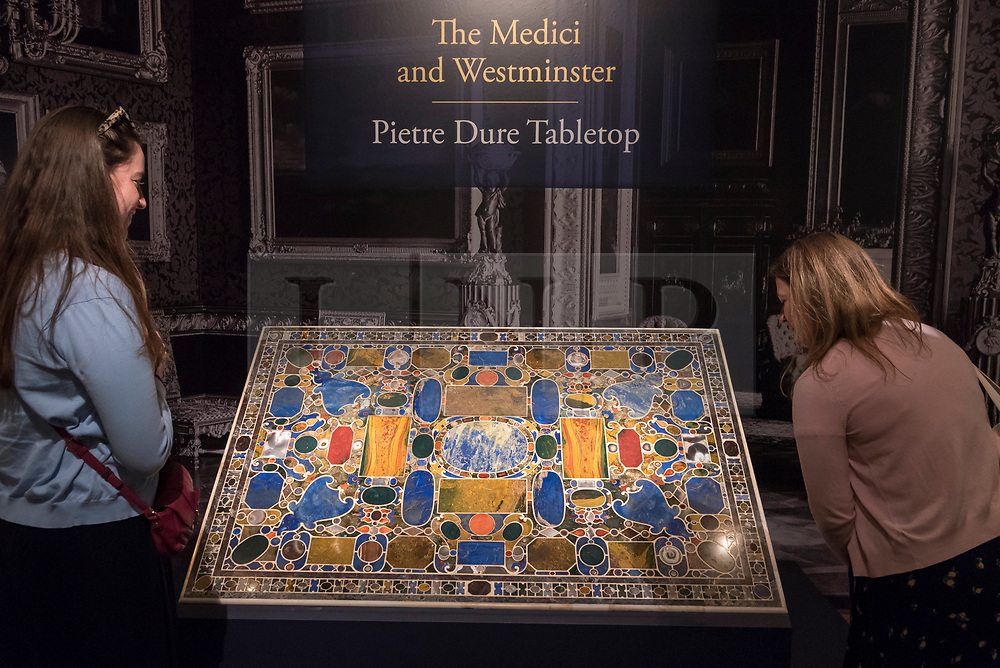 """© Licensed to London News Pictures. 28/06/2018. LONDON, UK. Visitors view """"The Grand Duke Francesco I De Medici table top 'Il Tavolino Di Gioie'"""", 1568-77, by Bernardino Porfrio da Leccio.  Members of the public visit Masterpiece London, the world's leading cross-collecting art fair held in the grounds of the Royal Hospital Chelsea.  The fair brings together 160 international exhibitors presenting works from antiquity to the present day and runs 28 June to 4 July 2018.  Photo credit: Stephen Chung/LNP"""