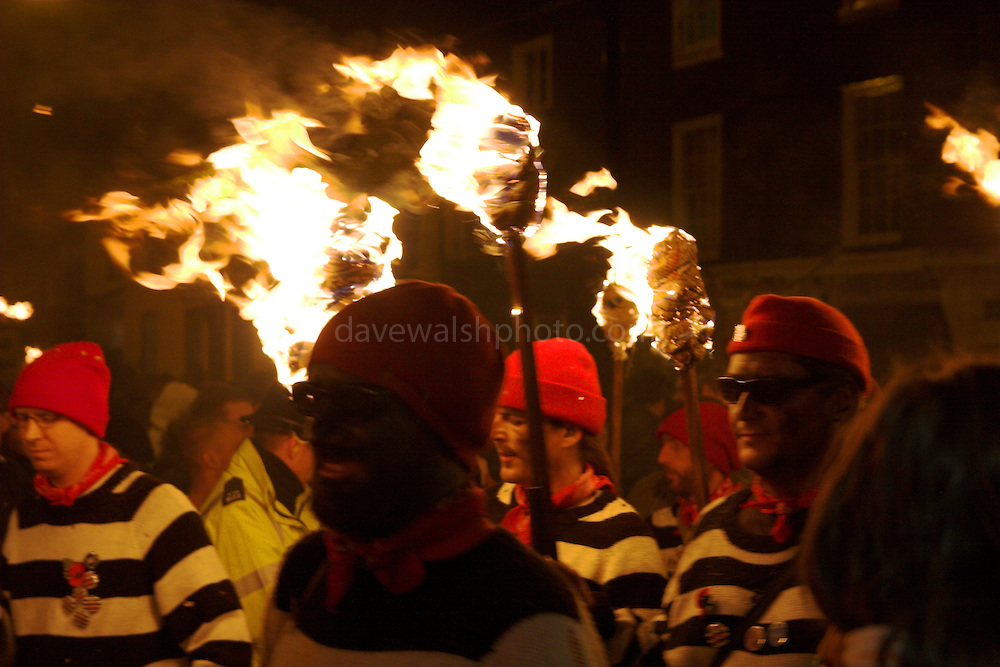 Late night 'unofficial' parade in Lewes, 5/11/05. Members of bonfire society in torchlight procession