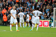 Swansea city players inc Gylfi Sigurdsson © look dejected after they concede the 3rd Manchester city goal. Premier league match, Swansea city v Manchester city at the Liberty Stadium in Swansea, South Wales on Saturday 24th September 2016.<br /> pic by Andrew Orchard, Andrew Orchard sports photography.