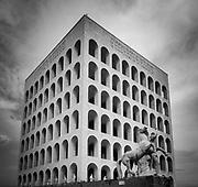 The Palazzo della Civiltà Italiana, also known as the Palazzo della Civiltà del Lavoro or simply the Colosseo Quadrato (Square Colosseum), is an icon of Fascist architecture.<br /> <br /> The building was designed in 1937 to host the Mostra della Civiltà Romana during the 1942 World Fair by Italian architects Giovanni Guerrini, Ernesto Bruno La Padula  and Mario Romano.<br /> <br /> It lies in the district of Rome known as the Esposizione Universale Roma (also known as 'E.42' and 'EUR'). It is particularly symbolic of this district, exemplifying its monumentality.