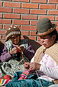 Bolivia June 2013. Cajamarca. Meeting with women who knit gloves whilst they listen.