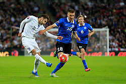 Adam Lallana of England passes under pressure from Taijo Teniste of Estonia - Mandatory byline: Jason Brown/JMP - 07966 386802 - 09/10/2015- FOOTBALL - Wembley Stadium - London, England - England v Estonia - Euro 2016 Qualifying - Group E