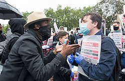 © Licensed to London News Pictures. 06/06/2020. London, UK. A protestor argues angrily with a socialist activist, accusing him and his campaign of highjacking the protest. Protesters gather in Westminster, central London during a Black Lives Matter demonstration over the killing of African American George Floyd. The death of George Floyd, who died after being restrained by a police officer In Minneapolis, Minnesota, caused widespread rioting and looting across the USA. Photo credit: Ben Cawthra/LNP