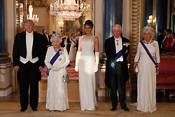 (left to right) Us President Donald Trump, Queen Elizabeth II, Melania Trump, the Prince of Wales and the Duchess of Cornwall, during a group photo ahead of the State Banquet at Buckingham Palace, London, on day one of US President Donald Trump's three day state visit to the UK.