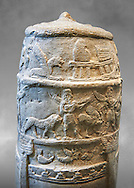 Stone Stele depicting  a ceremonial procession of Babylonian Gods. Circa 1186-1172 BC excavated from Susa where it had been taken as a spoil of war. Under the coils of the snake that wraps around the stele are represented the principal divinities of pantheon of Babylon as symbols. Below is a procession of two musicians and animals. Crenellated walls and towers surround the area reserve for an inscription that was never engraved. A horned serpent, emblem of the god Marduk, wraps around the base. Inv Sb 25. The Louvre Museum, Paris. .<br /> <br /> If you prefer to buy from our ALAMY PHOTO LIBRARY  Collection visit : https://www.alamy.com/portfolio/paul-williams-funkystock/babylon-antiquities.html    Type -     Louvre   - into the LOWER SEARCH WITHIN GALLERY box to refine search by adding background colour, place, museum etc<br /> <br /> Visit our ANCIENT WORLD PHOTO COLLECTIONS for more photos to download or buy as wall art prints https://funkystock.photoshelter.com/gallery-collection/Ancient-World-Art-Antiquities-Historic-Sites-Pictures-Images-of/C00006u26yqSkDOM