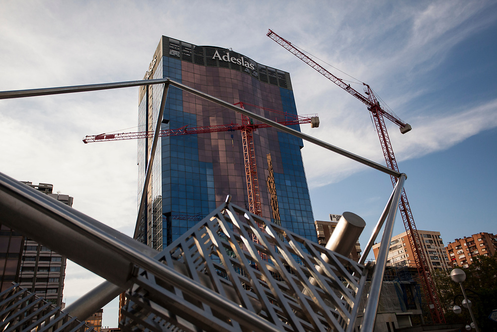 MADRID, SPAIN - OCTOBER 9: Several cranes work on the construction of new buildings at Azca business area on October 9, 2020 in Madrid, Spain. Azca, considered the business heart of the city, is a business and leisure area in Madrid spanning from Nuevos Ministerios to the Santiago Bernabeu stadium, flanked by Paseo de la Castellana and Calle Orense, two of the most iconic streets in the capital. Madrid's Mayor José Luis Martínez Almeida has announced a partnership with private investors including stock-trading companies Merlin and GMP, in order to revamp the area by promoting the development of a modern space with the best business and leisure facilities. (Photo by Miguel Pereira/Getty Images)