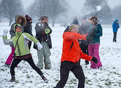 "© Licensed to London News Pictures. 02/03/2018. Bristol, UK. A mass snowball fight takes place on Bristol Downs in the snow from the ""Beast from the East"" winter weather. Photo credit: Simon Chapman/LNP"