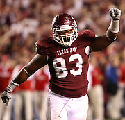 Nov 20, 2010; College Station, TX, USA; Texas A&M Aggies defensive tackle Tony Jerod-Eddie (83) celebrates after stopping the Nebraska Cornhuskers on third down during the fourth quarter at Kyle Field.  Texas A&M won 9-6. Mandatory Credit: Thomas Campbell-US PRESSWIRE
