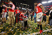 Dontre Wilson #2 of the Ohio State Buckeyes celebrates with Jacob Jarvis, 14, who has been diagnosed with Duchenne muscular dystrophy and been a big part of the 2014 Ohio State team after they defeated the Oregon Ducks during the College Football Playoff National Championship Game at AT&T Stadium on January 12, 2015 in Arlington, Texas.  (Cooper Neill for The New York Times)