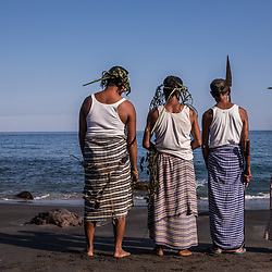 """Leva (Ocean) Season Opening Ceremony<br /> <br /> The villagers are all devoted Christians and they have well established a coexistence of their original belief and Christianity – a transition which has been largely influenced by a German priest who arrived in Lamalera some 100 years ago. Even the bravest whale hunters need otherworldly (spiritual) support. During the """"Ie Gerek"""" ceremony on the first day of """"Leva Seson Opening"""" the leaders of the 3 major clans will adventure to the top of the mountain, requesting the land owner's permission to open the new Leva Season. The spiritual leader of the Lango Fugon Clan will then sacrifice a chicken near the holy whale stone to call the whale spirit. Chosen leaves of the mountain's vegetation which bare the whale spirit will be carried down to the beach, to be drowned in the surf. <br /> <br /> Before the Catholic missionaries arrived in Lamalera, the villagers believed in Lara Wulan """"the god of the sky"""", Tana Ekan """"the god of the earth"""" and """"Ina Leva"""" the mother of the sea. Additionally they were worshipping their ancestors (which became saints with the rise of Christianity). These forefathers are responsible to faithfully carry the wishes to Lara Wulan. The priests made them believe that water has been created by God. This has been was accepted, as it was quite easy to replace Ina Leva by holy Mother Mary. Ina Leva alias Mother Mary together with their ancestral saints will always prepare food for this village – which are the whales."""