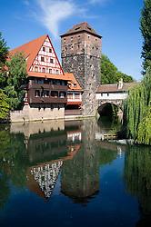 View of historic Wine Vault or Weinstadel, water tower and Hangman's Way or Henkersteg  beside Pegnitz River in Nuremberg, Germany
