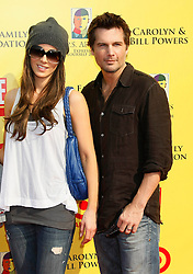 """Photo by: NPX/starmaxinc.com<br /> ©2008<br /> <br /> 11/16/08<br /> Kate Beckinsale with Len Wiseman and daughter at the 11th Anniversary Of P.S. Arts """"Express Yourself 2008"""".<br /> (Santa Monica, CA)"""