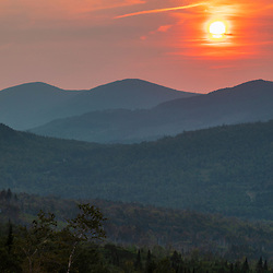 The sun sets behind Moose Mountain in Eustis, Maine. Boundary Mountains region. Site of proposed CMP transmission corridor.