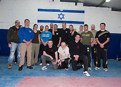 Avi Moyal, chairman of the IKMF, poses with the students at the end of their first day seminar in an introduction to Krav Maga for civilians. The IKMF Train & Travel in Israel is a unique ten day program designed for IKMF's instructors, students & guests, interested in combining Krav Maga training with a tour of the holy land. Friday, 31st December 2010 at the Olympic shooting academy.