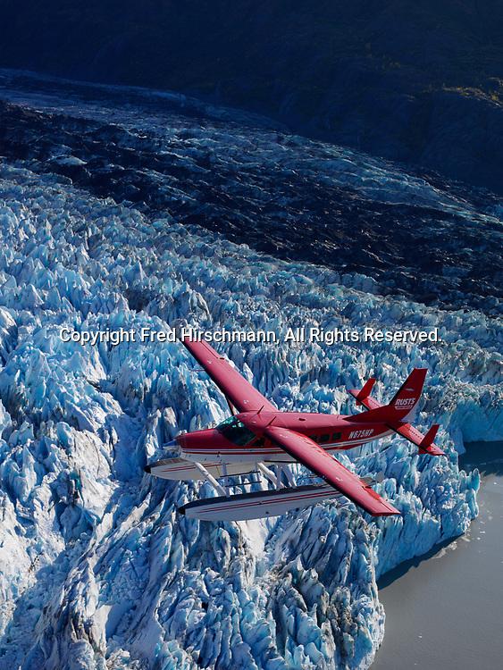 Rust's Flying Service Cessna 208 Caravan on floats flying above Colony Glacier, Lake George, Alaska.