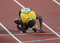 Athletics - 2017 IAAF London World Athletics Championships - Day Two, Evening Session<br /> <br /> Mens 100m Final <br /> <br /> Usain Bolt (Jamaica) kisses the finish line on his last appearance in the World Championship at the London Stadium<br /> <br /> COLORSPORT/DANIEL BEARHAM