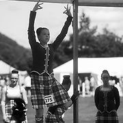 Highland Games, 3rd of August 2019, Newtonmore, Scotland, United Kingdom. Young girls perform their dance in front of a judge as part of the dance competition. The Highland Games is a traditional annual event where competitors compete as strong men, runners, dancers, pipers and at tug-of-war. The games go back centuries and are happening through-out the summer across Scotland. The games are both an important event locally and a global tourist attraction.