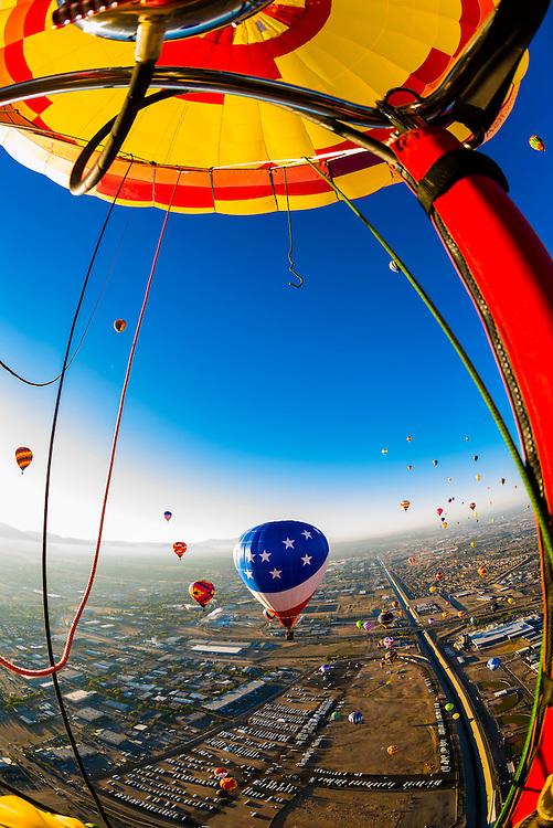 Hot air balloons flying at the Albuquerque International Balloon Fiesta, Albuquerque, New Mexico USA.