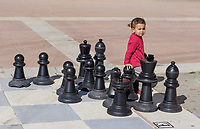 Toddler, child, girl, female, open-air, chessboard, chess board, promenade, Estepona, Malaga, Spain, February, 2019, 201902018390<br /><br />Copyright Image from Victor Patterson, Belfast, UK, BT9 5HG<br /><br />t: +44 28 9066 1296 <br />(from Rep of Ireland 048 9066 1296) <br />m: +44 7802 353836 <br />victorpattersonbelfast@gmail.com <br />www.victorpatterson.com<br /><br />Please see my Terms and Conditions of Use at https://www.victorpatterson.com/page2 <br /><br />It is IMPORTANT that you familiarise yourself with them.<br /><br />Images used on the Internet incur an additional cost and must be visibly watermarked i.e. © Victor Patterson within the body of the image and copyright metadata must not be deleted. Images used on the Internet have a size restriction of 4kbs and are chargeable at rates available at victorpatterson.com.<br /><br />This image is only available for the use of the download recipient i.e. television station, newspaper, magazine, book publisher, etc, and must not be passed on to any third party. It is also downloaded on condition that each and every usage is notified within 7 days to victorpattersonbelfast@gmail.com<br /><br />The right of Victor Patterson to be identified as the author is asserted in accordance with The Copyright Designs And Patents Act (1988). All moral rights are asserted.