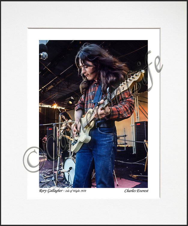 """Rory Gallagher - An affordable archival quality matted print ready for framing at home.<br />  Ideal as a gift or for collectors to cherish, printed on Fuji Crystal Archive photographic paper set in a neutral mat (all mounting materials are acid free conservation grade). <br />  The image (approx 6""""x8"""") sits within a titled border. The outer dimensions of the mat are approx 10""""x12"""""""