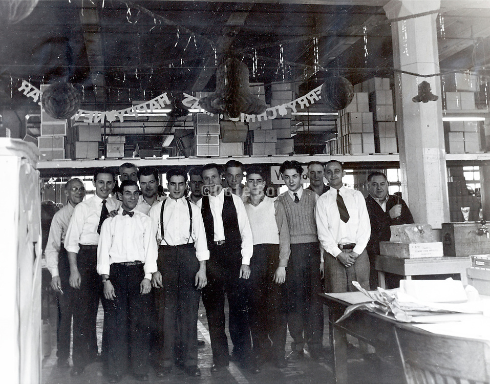 office and floor workers posing for a group portrait USA 1940s