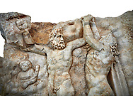 Close up of a Roman Sebastian relief sculpture of Zeus and Prometheus, Aphrodisias Museum, Aphrodisias, Turkey.      Against a white background.<br /> <br /> Prometheus is screaming in pain. Zeus had given him a terrible punishment for giving fire to man: he was tied to the Caucasus mountains and had his liver picked out daily by an eagle. Herakles shot the eagle and is undoing the first manacle. He wears his trade mark lion-skin and thrown his club to one side. A small mountain nymph, holding a throwing stick appears amongst the rocks. .<br /> <br /> If you prefer to buy from our ALAMY STOCK LIBRARY page at https://www.alamy.com/portfolio/paul-williams-funkystock/greco-roman-sculptures.html . Type -    Aphrodisias     - into LOWER SEARCH WITHIN GALLERY box - Refine search by adding a subject, place, background colour, museum etc.<br /> <br /> Visit our ROMAN WORLD PHOTO COLLECTIONS for more photos to download or buy as wall art prints https://funkystock.photoshelter.com/gallery-collection/The-Romans-Art-Artefacts-Antiquities-Historic-Sites-Pictures-Images/C0000r2uLJJo9_s0