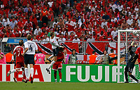 Photo: Glyn Thomas.<br />England v Trinidad & Tobago. Group B, FIFA World Cup 2006. 15/06/2006.<br /> England's Peter Crouch (C) opens the scoring for his team.
