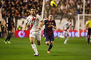Leo Messi fights for the ball with Jordi Amat, defender of Rayo Vallecano