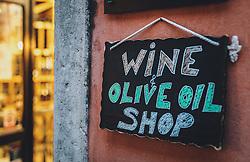 THEMENBILD - ein Schild vor einem Wein- und Öl-Fachgeschäft, aufgenommen am 03. Juli 2020 in Novigrad, Kroatien // a sign outside a wine and oil shop, in Novigrad, Croatia on 2020/07/03. EXPA Pictures © 2020, PhotoCredit: EXPA/ Stefanie Oberhauser