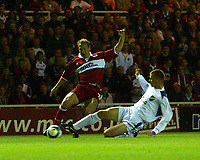 Photo. Andrew Unwin.<br /> Middlesbrough v Banik Ostrava, UEFA Cup, First Round, First Leg, Riverside Stadium, Middlesbrough 16/09/2004.<br /> Banik Ostrava's Pavel Besta (R) slides in with a crucial tackle on Middlesbrough's Ray Parlour (L)<br /> NORWAY ONLY