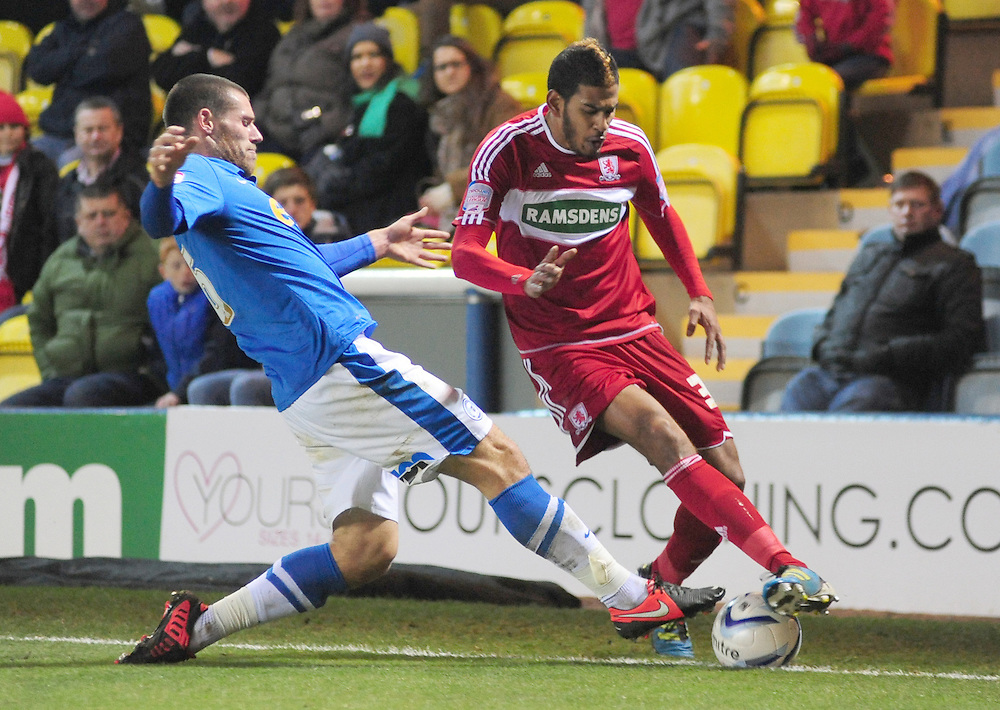 Middlesbrough's Faris Haroun vies for possession with Peterborough United's Michael Bostwick ..Football - npower Football League Championship - Peterborough United v Middlesbrough - Saturday 8th December 2012 - London Road - Peterborough..