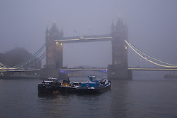 © Licensed to London News Pictures. 22/01/2013. London, UK. Tower Bridge is seen through fog in London today (22/01/13) as Britain braces itself for further cold weather. Photo credit: Matt Cetti-Roberts/LNP