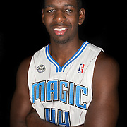 Andrew Nicholson poses in front of a backdrop during the Orlando Magic media day event at the Amway Arena on Monday, September 30, 2103 in Orlando, Florida. (AP Photo/Alex Menendez)