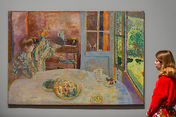 "© Licensed to London News Pictures. 21/01/2019. LONDON, UK. A staff member views ""The Dining Room, Vernon"", 1925, by Pierre Bonnard.  Preview of an exhibition called ""Pierre Bonnard: The Colour of Memory"" at Tate Modern.  This is the UK's first major Pierre Bonnard exhibition in 20 years bringing together around 100 of his works from around the world covering a period from 1912 to his death in 1947.  The works are on show 23 January to 6 May 2019.  Photo credit: Stephen Chung/LNP"